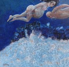 homme et femme sous l'eau